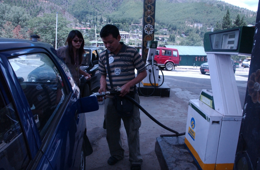 BHUTAN WOMAN PETROL STATION HIGH OIL PRICE