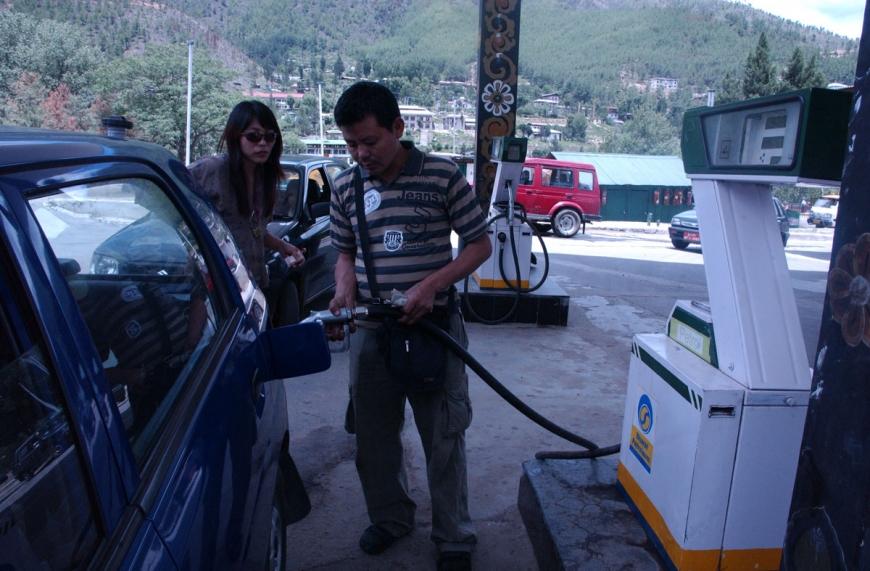 BHUTAN WOMAN PETROL STATION HIGH OIL PRICE