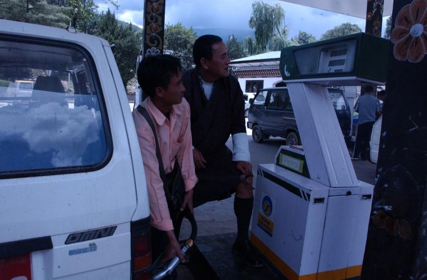 TAXI DRIVER BHUTAN PETROL STATION HIGH OIL PRICE